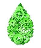 Gota verde del ambiente hecha de engranajes y de dientes Fotos de archivo libres de regalías