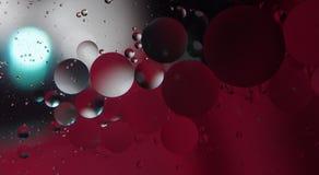 Gotas abstratas da fotografia do óleo na água Foto de Stock Royalty Free