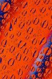 Gotas alaranjadas e azuis Imagens de Stock Royalty Free