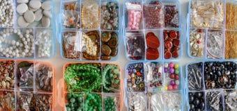 Gotas coloridas en cajas Fotos de archivo
