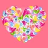 Gotas coloridas que salpican el corazón sobre color de rosa Fotos de archivo libres de regalías