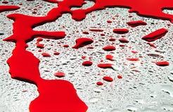 Gotas da água e fundo do sangue Fotografia de Stock Royalty Free