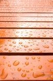 Gotas da água em de madeira Imagem de Stock Royalty Free