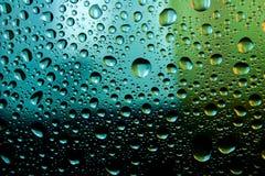 Gotas da água no fundo azul Fotos de Stock Royalty Free