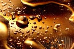 Gotas da água - ouro profundo Fotografia de Stock