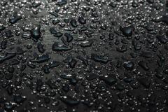 Gotas da chuva na superfície do carro, fundo abstrato foto de stock royalty free