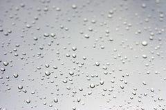 Gotas da chuva no indicador Imagem de Stock