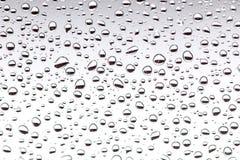 Gotas da chuva no vidro, fundo textu do fundo da gota da água Foto de Stock
