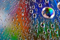 Gotas da água na superfície da difração Imagem de Stock Royalty Free