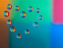 Gotas de água no vidro sob a forma do coração Fotografia de Stock Royalty Free