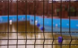 Gotas de agua en la cerca Foto de archivo libre de regalías