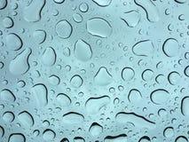 Gotas de agua gordas en ventana Foto de archivo libre de regalías