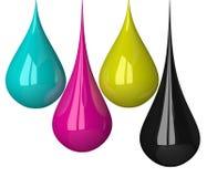 Gotas de cores de CMYK Imagem de Stock