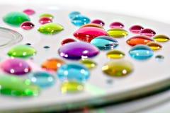 Gotas de la tinta en el CD Fotos de archivo libres de regalías
