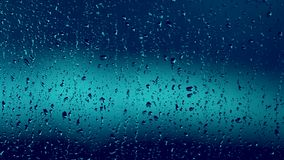 Gotas de lluvia azules en ventana almacen de video
