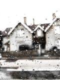 Gotas de lluvia en la ventanilla del coche Fotos de archivo
