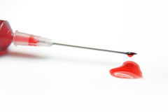 Gotas de sangre en forma de corazón Foto de archivo libre de regalías