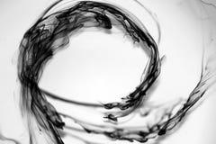 Gotas de tinta preta Fotografia de Stock