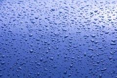 Gotas del agua azul Imagenes de archivo