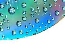 Gotas del agua en el CD Imagen de archivo libre de regalías