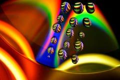 Gotas del agua en el CD Foto de archivo libre de regalías