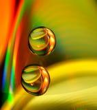 Gotas del agua en el CD Fotografía de archivo