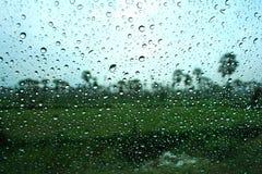 Gotas del agua en ventana Fotos de archivo libres de regalías