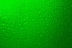 Gotas del agua en verde Fotografía de archivo libre de regalías