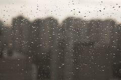 Gotas del agua sobre el vidrio Fotografía de archivo