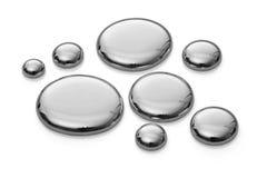 Gotas del mercurio en blanco. Mismo sostenido. Imagen de archivo libre de regalías