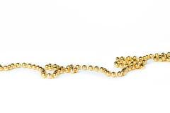 Gotas del topetón de la Navidad del oro en blanco Imágenes de archivo libres de regalías