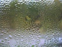 Gotas do vidro e da chuva de indicador Fotografia de Stock Royalty Free
