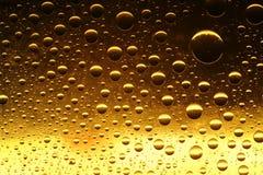 Gotas douradas Imagem de Stock Royalty Free