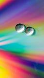 Gotas en el CD-disco Fotografía de archivo libre de regalías