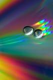 Gotas en el CD-disco Fotos de archivo libres de regalías