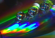 Gotas en el CD-disco imagen de archivo libre de regalías