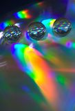 Gotas en el CD-disco Imágenes de archivo libres de regalías