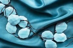 Gotas en el satén Imagen de archivo libre de regalías