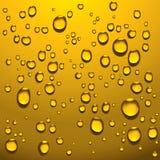 Gotas líquidas douradas Fotos de Stock