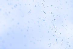 Gotas mojadas sobre un vidrio Imágenes de archivo libres de regalías