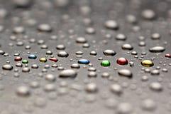 Gotas pintadas da água Foto de Stock Royalty Free