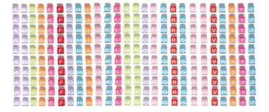 Gotas plásticas coloridas con las letras Fotos de archivo