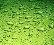 Gotas verdes del agua Foto de archivo libre de regalías
