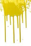 Gotejamento amarelo da pintura Fotografia de Stock