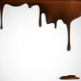 Goteo derretido del chocolate. Fotografía de archivo