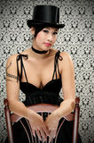 Goth Girl. Beautiful Asian Girl Dressed In A Victorian Dress With Top Hat leaning On A Chair Royalty Free Stock Images