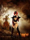 Goth girl in cemetary on halloween night Stock Image