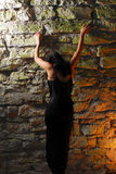 Goth Girl Climbing Wall Stock Photos