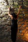Goth Girl Climbing Wall Stock Photos