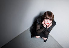 Goth girl in a corner Stock Photo